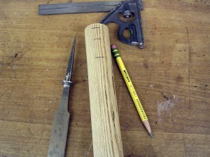 The chisel and the new handle blank layed out for drilling.