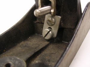 The frog adjusting screw.