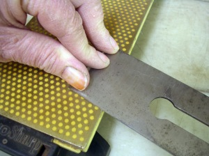 Flattening the back of an iron.